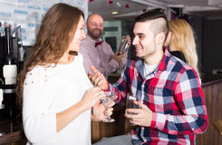 Man picking up woman in bar Stock Photography