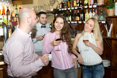 Man picking up women in bar Stock Photography