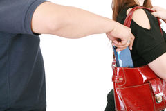 Man pickpocketing a purse from womans bag Royalty Free Stock Photos