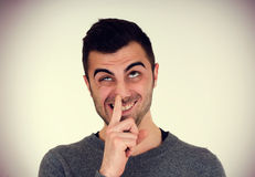 Man picks his nose. Young man with beard,  picks his nose, vintage effect Stock Images