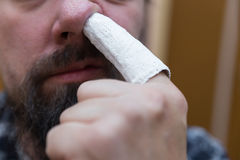 Man picks up with injured finger Stock Photography