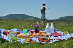 Man on Picnic Spreading His Arms Stock Image
