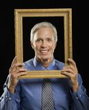 Man in picture frame. Royalty Free Stock Photos