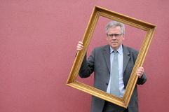 Man with picture frame Royalty Free Stock Image