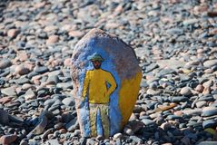 Man. Picture on a stone. Stock Image