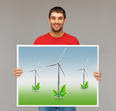Man with picture of wind turbines Royalty Free Stock Photography