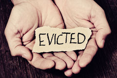 Man with a piece of paper with the word evicted Royalty Free Stock Image
