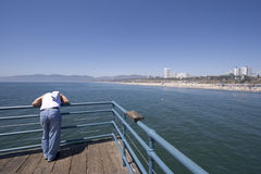 Man on pier. Man standing on the Santa Monica pier Royalty Free Stock Images