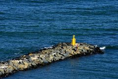 Man on the pier on the Black sea coast. Top summer attraction in Romania royalty free stock photo