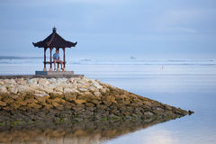 Man on the pier in Indonesia. Man is staying on the pier Royalty Free Stock Images