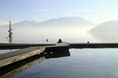Man on pier, Lake Annecy, France  Stock Photography