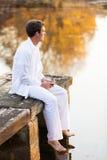 Man pier lake Stock Photography