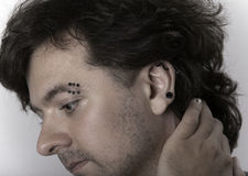 Man with piercings stock photos