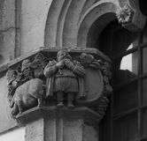 Man and pig. Shot in black and white. Placed on the facade of this historic building, sculpture on the capital representing man and pig. Set in Garraf, Sitges Royalty Free Stock Photo