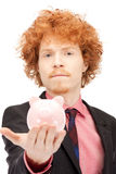 Man with piggy bank Royalty Free Stock Images