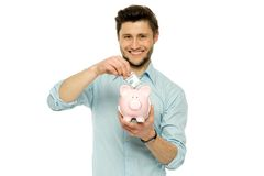 Man with piggy bank Royalty Free Stock Photos