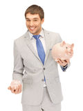 Man with piggy bank Stock Image