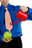 Man with piggy bank and can Stock Photography