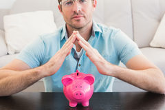 A man with piggy bank Royalty Free Stock Photo