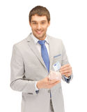 Man with piggy bank and money Royalty Free Stock Photo