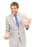 Man with piggy bank Stock Photo