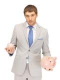 Man with piggy bank Stock Image