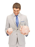 Man with piggy bank Royalty Free Stock Photo