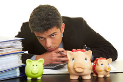 Man with piggy banks Royalty Free Stock Photo