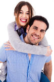 Man piggyback his girlfriend Stock Photography