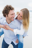 Man piggybacking woman at beach Royalty Free Stock Image