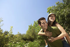 Man Piggybacking Woman At Park Royalty Free Stock Photos