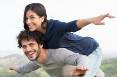 Man Piggybacking Woman Stock Image