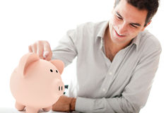 Man with a piggybank Royalty Free Stock Photography
