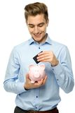 Man with piggybank and credit card Stock Photo