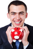 Man with piggybank Stock Images