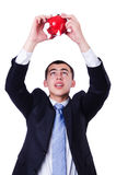 Man with piggybank. Isolated on white royalty free stock photos