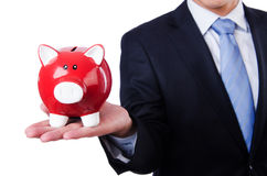 Man with piggybank. Isolated on white Stock Photography