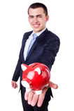 Man with piggybank. Isolated on white Royalty Free Stock Image