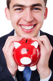 Man with piggybank. Isolated on white Royalty Free Stock Images