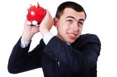 Man with piggybank Royalty Free Stock Photography
