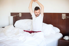 Man in pijamas waking up Royalty Free Stock Images