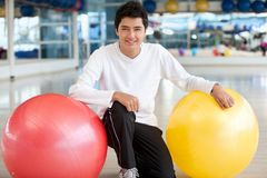 Man with pilates ball Royalty Free Stock Photos