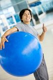 Man with a pilates ball Stock Image