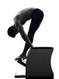 Man pilates chair exercises fitness isolated Stock Image
