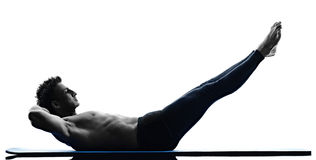 Man pilates exercises fitness isolated Stock Image