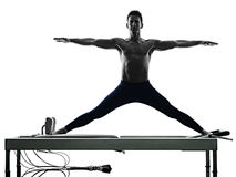 Man pilates reformer exercises fitness isolated Stock Image