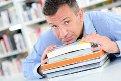 Man with pile books Royalty Free Stock Image
