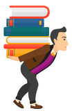 Man with pile of books Stock Photo