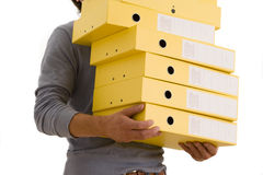 Man with pile of box files, mid section, cut out Stock Photos