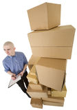 Man and pile cardboard boxes Stock Photos